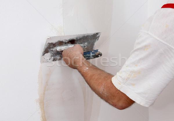 Travailleur plâtre mur maison construction Photo stock © simazoran