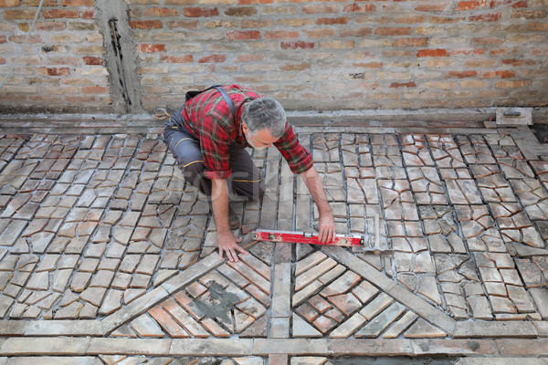 Pavement or terrace making, worker control level Stock photo © simazoran