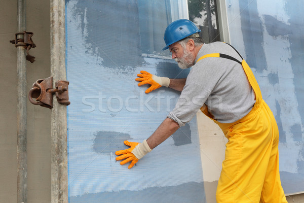 Styrofoam facade insulation, installing mesh Stock photo © simazoran