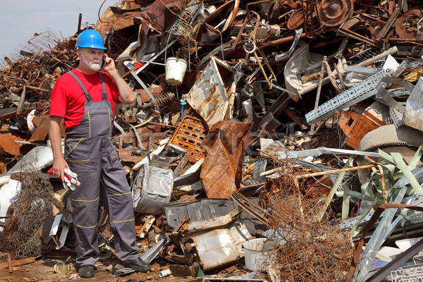 Recycling industry, heap of old metal and worker Stock photo © simazoran