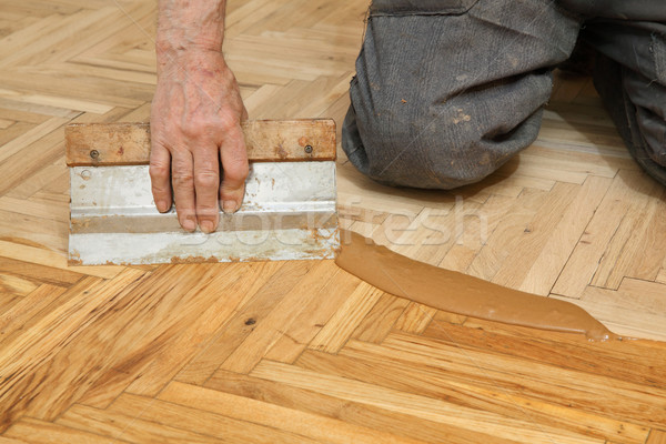 Home renovation, parquet finishing Stock photo © simazoran