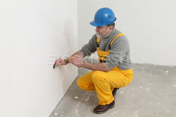 Electrician at construction site testing installation Stock photo © simazoran