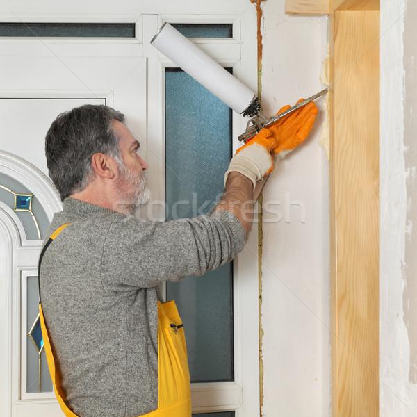 Munkás installál fából készült ajtó hab installál Stock fotó © simazoran