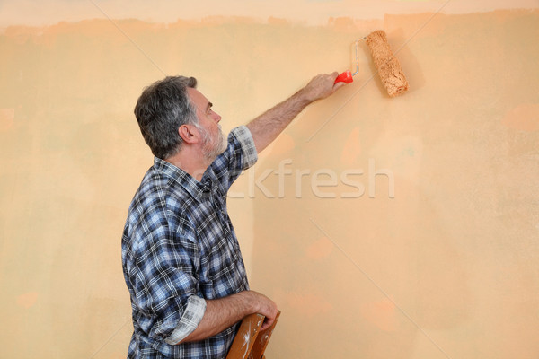Worker painting wall in a room Stock photo © simazoran