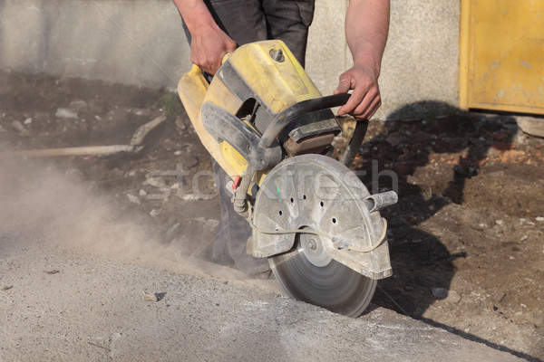 Construction site, worker cut asphalt with saw blade toll Stock photo © simazoran