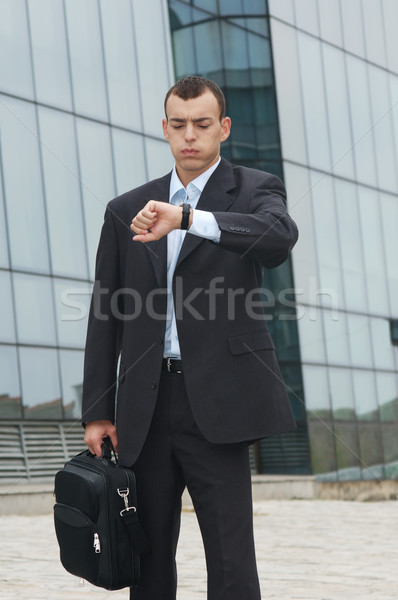 Homme d'affaires jeunes temps grimace visage affaires Photo stock © simazoran