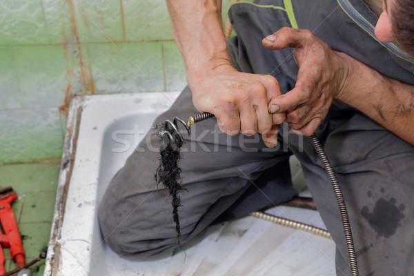 Instalacyjnych hydraulik czyszczenia włosy drenażu łazienka Zdjęcia stock © simazoran