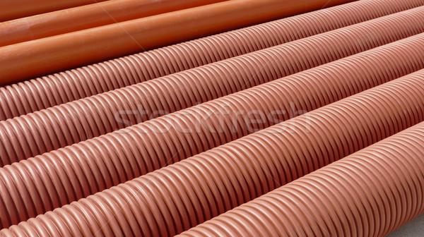 Heap of plastic ribbed tubes Stock photo © simazoran