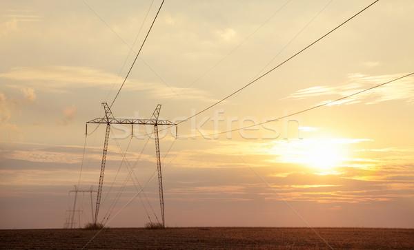 Eletricidade alta tensão pôr do sol nuvens natureza Foto stock © simazoran