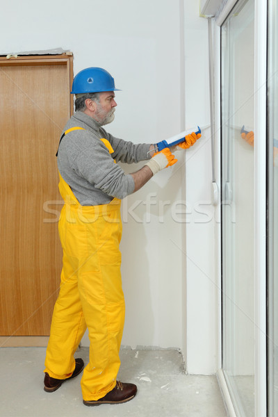 Home renovation, caulking with silicone Stock photo © simazoran