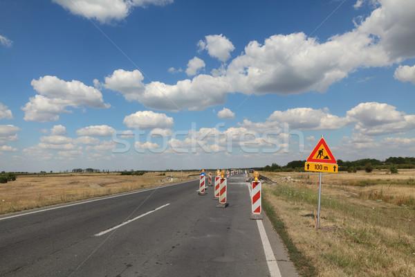 Autostrada strada ricostruzione segnaletica stradale cielo blu nubi Foto d'archivio © simazoran