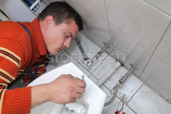 Csövek vízvezetékszerelő megjavít vízcsap építkezés dolgozik Stock fotó © simazoran