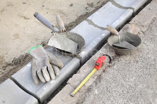 Construction site, curb stone and mason tools Stock photo © simazoran