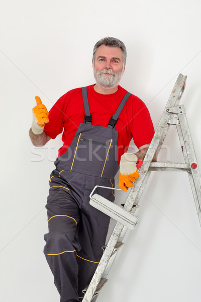 Worker painting wall in room Stock photo © simazoran