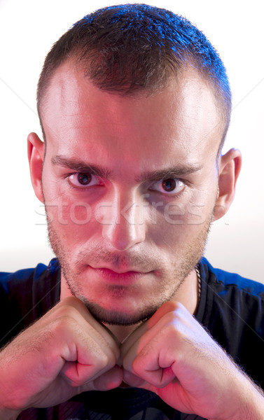 Moço estúdio jovem caucasiano zangado homem Foto stock © simazoran