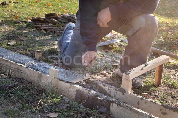 Construction worker making concrete foundation in formwork Stock photo © simazoran