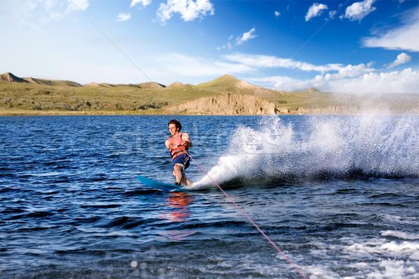 водные лыжи мужчины озеро вечер воды счастливым Сток-фото © SimpleFoto