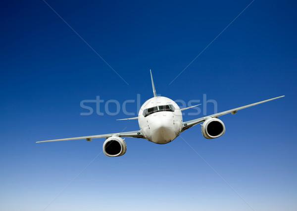 Avión vuelo brillante cielo azul cielo azul Foto stock © SimpleFoto