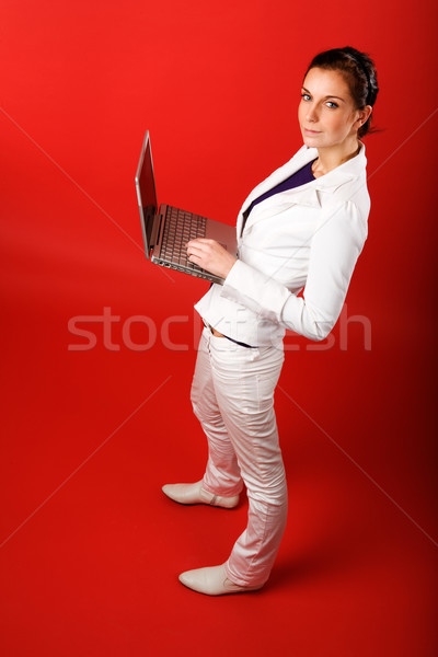 Female with Computer on Red Stock photo © SimpleFoto
