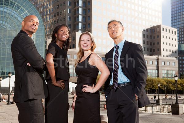 Zespół firmy sprawdzać działalności uśmiech człowiek Zdjęcia stock © SimpleFoto