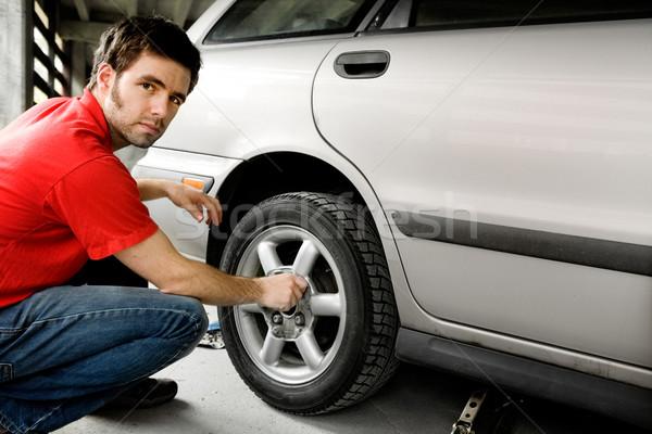 Male Changing Tire Stock photo © SimpleFoto