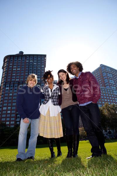 Négy személy városi park alulról fotózva kilátás függőlegesen Stock fotó © SimpleFoto