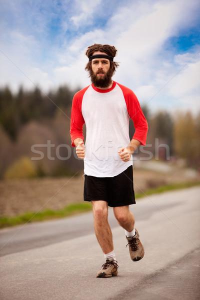 Zmęczony uprawiający jogging w stylu retro uruchomiony drogowego odkryty Zdjęcia stock © SimpleFoto