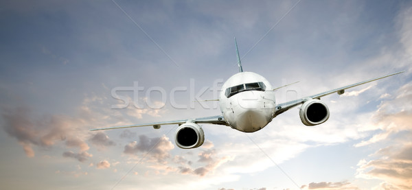 Repülőgép repülés naplemente égbolt kék légy Stock fotó © SimpleFoto