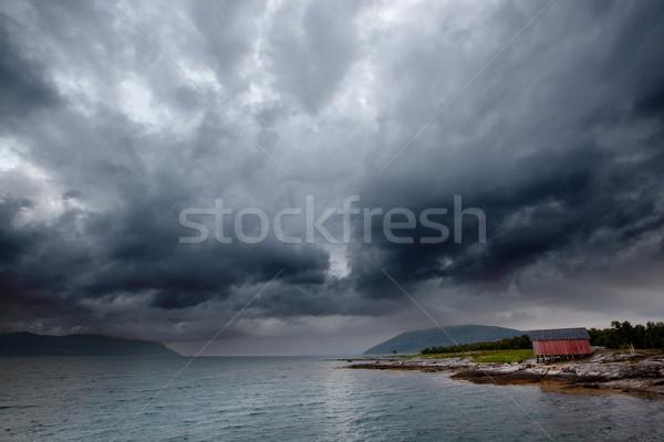 Mar tormenta océano puesta de sol edificio paisaje Foto stock © SimpleFoto