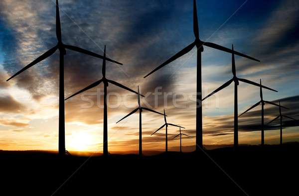 Parque eólico viento poder paisaje puesta de sol cielo Foto stock © SimpleFoto