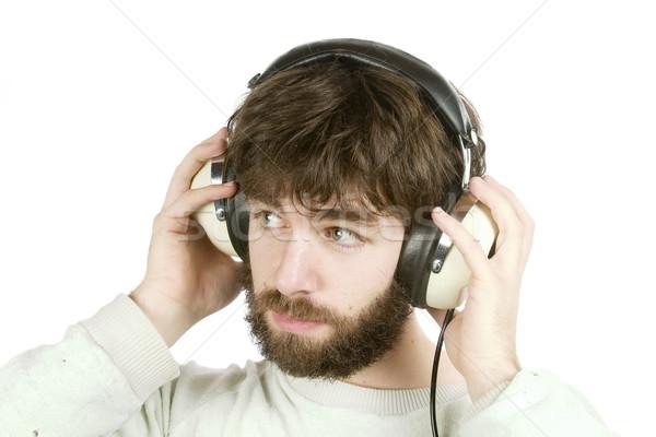懐疑的な 音楽 若い男 見える 音楽を聴く ヘッドホン ストックフォト © SimpleFoto