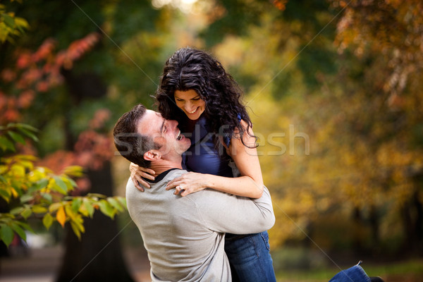 Excité homme femme couple grand hug Photo stock © SimpleFoto
