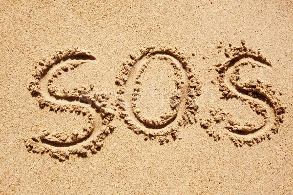 Sos geschreven zand vinger stick achtergrond Stockfoto © SimpleFoto