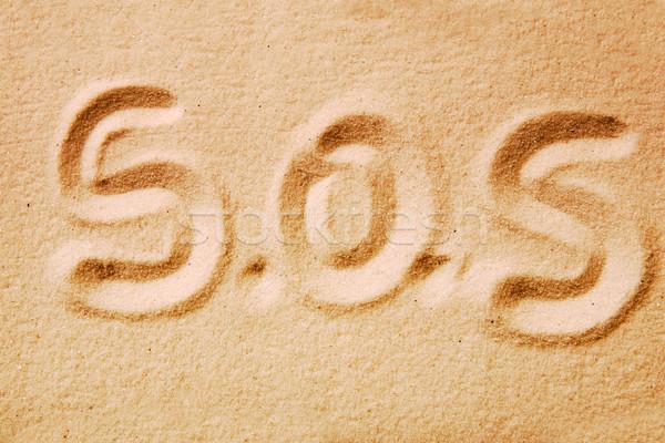 Sos írott arany homok gyötrelem üzenet Stock fotó © SimpleFoto