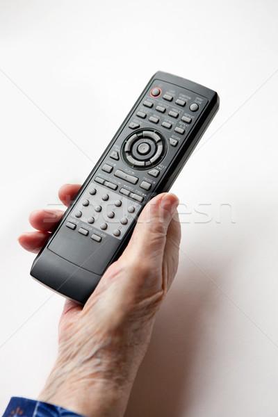 Foto stock: Control · remoto · ancianos · mano · tv · mujer · tecnología