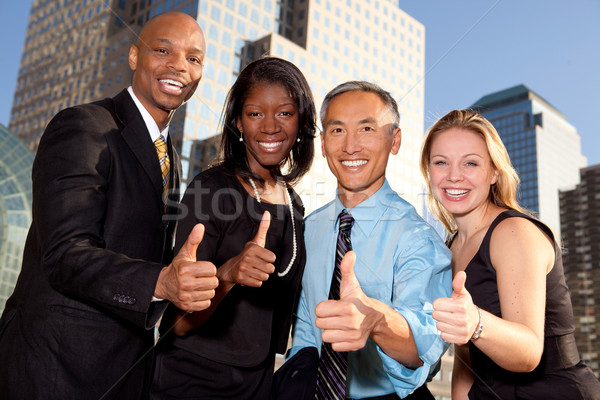 Exitoso gente de negocios signo negocios Foto stock © SimpleFoto