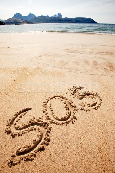 Sos escrito arena isla océano distancia Foto stock © SimpleFoto