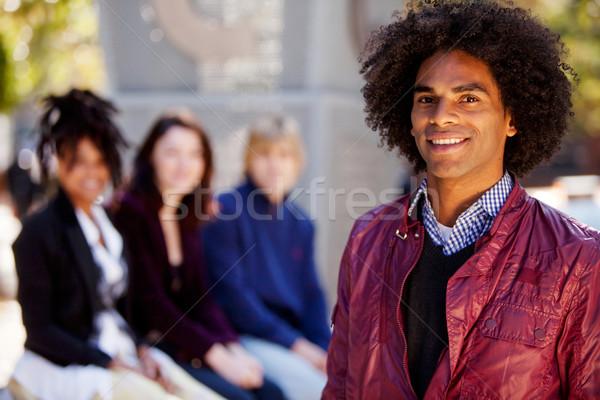 Quatro pessoas um homem ponto grupo diferente Foto stock © SimpleFoto