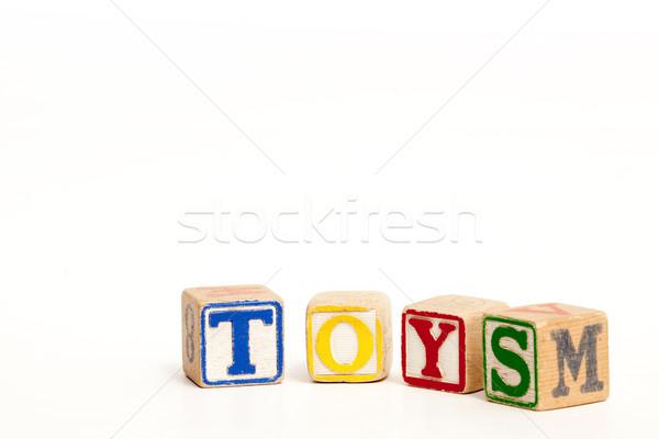 Játékok építőkockák izolált fehér helyesírás szó Stock fotó © SimpleFoto