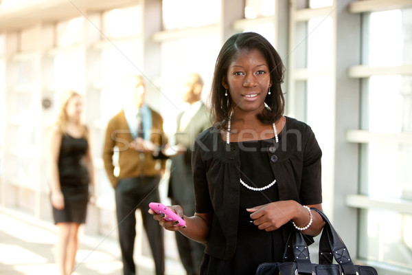 Business Woman with Smart Phone Stock photo © SimpleFoto