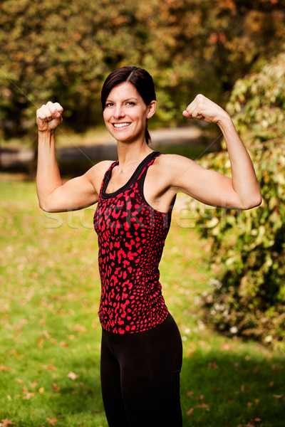 Bras flex fitness portrait femme heureux Photo stock © SimpleFoto