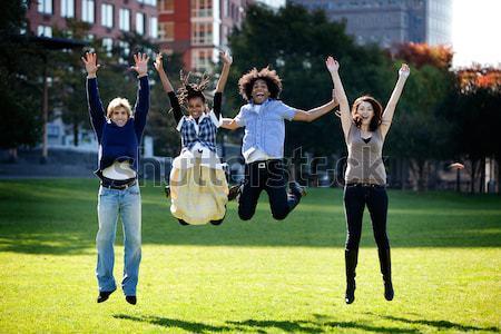 Ugrás öröm csoport boldog emberek fut kamera Stock fotó © SimpleFoto