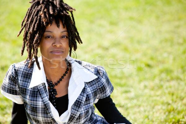 Vonzó fiatal nő ül park fiatal női Stock fotó © SimpleFoto