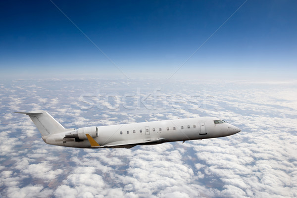 Repülőgép égbolt repülés magas magasság felhők Stock fotó © SimpleFoto