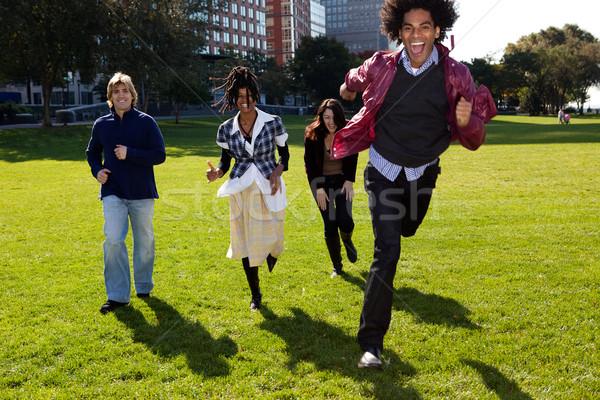Négy személy fut városi park függőlegesen mosoly Stock fotó © SimpleFoto
