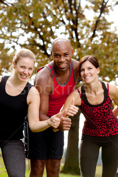 счастливым фитнес группа людей парка Сток-фото © SimpleFoto