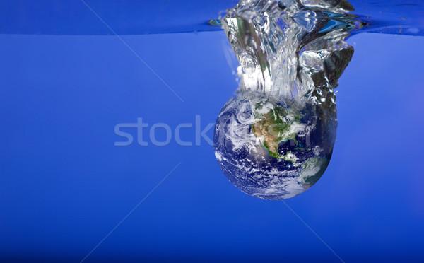 World Sinking in Water Stock photo © SimpleFoto