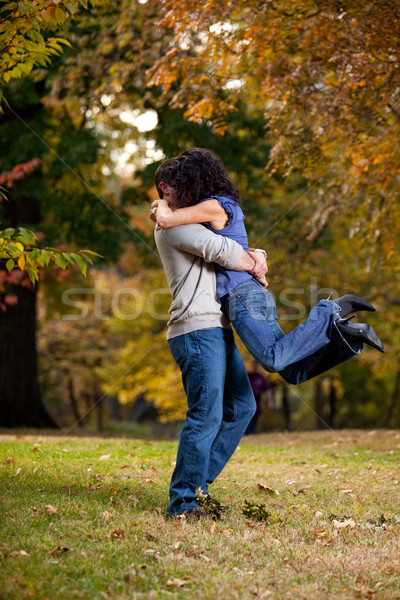 Groß hug Mann Frau Heben aus Stock foto © SimpleFoto