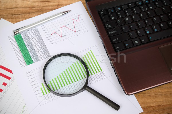 Magnifier on business wooden background Stock photo © simpson33