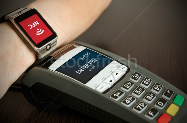 Man making payment through smartwatch via NFC technology Stock photo © simpson33